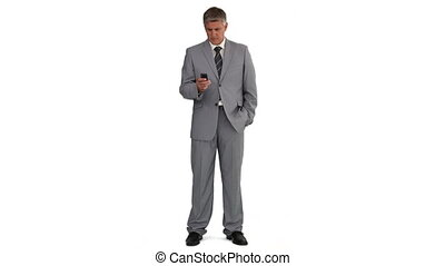 Elederly man in a suit using a remote control