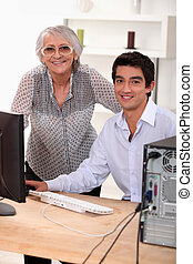 elederly woman learning how to use computer