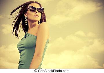 elegance - Portrait of a charming lady in beautiful elegant...