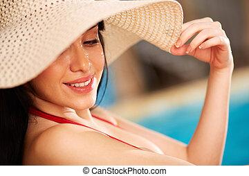 Elegance - Portrait of pretty young lady in hat enjoying ...