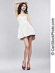Elegance. Stylish Brunette in Light Sundress posing. Fashion Style
