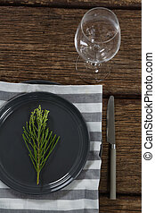 Elegance table setting with empty wine glass on wooden plank