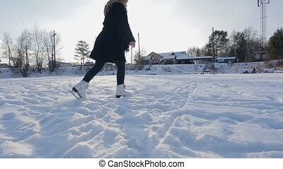 Elegance woman skates on snowy landscape. Frozen lake...