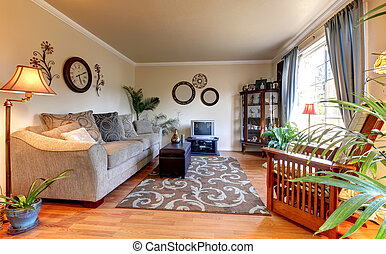 Elegand beige living room with blue and old small TV.
