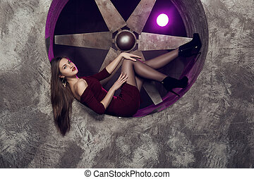 Elegant and beautiful top model near ventilation pipes...