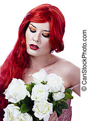 elegant and beautiful woman with red hair holding a bouquet of white roses
