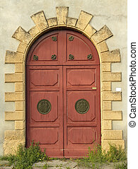 elegant antique arch double door to the abandoned tuscan...
