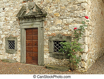 elegant antique door to the stone house , Tuscany, Italy , Europe