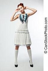 Elegant asian woman in fashion retro dress posing on podium