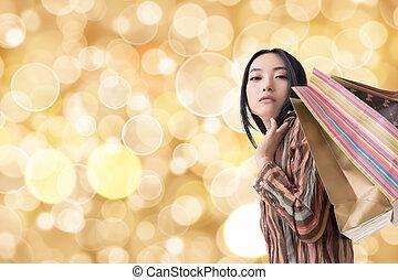 Elegant Asian woman shopping