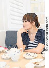 Elegant Asian woman thinking