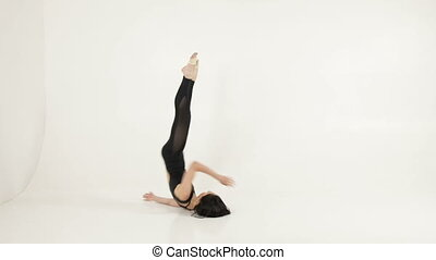 Elegant ballet dancer doing somersaults, slow motion