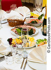 Elegant banquet and dinner tables prepared for a holiday or a party.