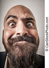 elegant bearded man with jacket and funny expressions