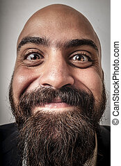 elegant bearded man with jacket and funny expressions on ...