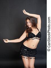dancing girl in a black suit