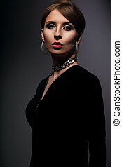 Elegant beautiful woman with fashion earrings and necklace...
