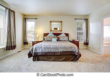 Elegant bedroom with beautiful bedding