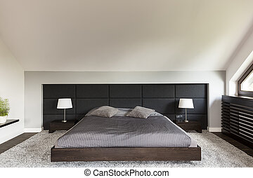 Elegant bedroom with large bed - Modern elegant bedroom with...