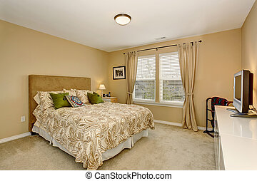 Elegant bedroom with patterned bedding.