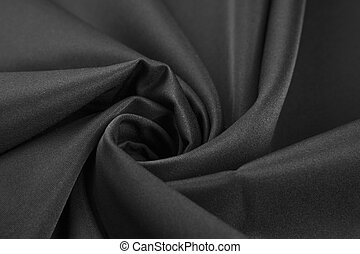 Elegant black satin silk with waves. Background or texture