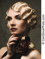 Elegant blond retro woman in black dress with beautiful rose flower