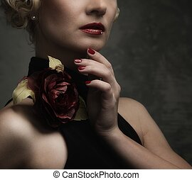 Elegant blond retro woman  in black dress with beautiful rose flower