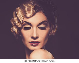 Elegant blond retro woman in veil with beautiful hairdo