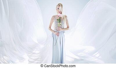 Elegant blond woman holding a long rose flower