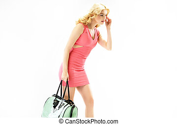 Elegant blond woman with a trendy handbag