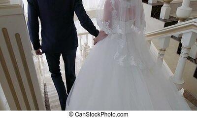 Elegant Bride down the stairs