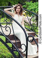 Elegant bride girl in white dress outdoor. Beautiful woman portrait