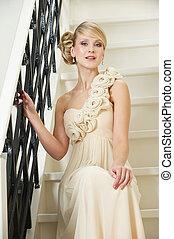 Elegant Bride Sitting on Stairs