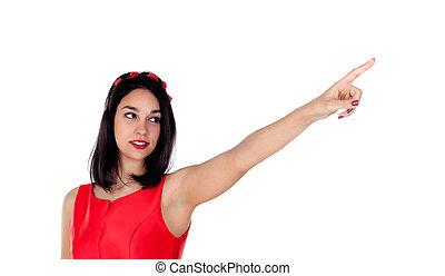 Elegant brunette girl indicating something with her finger