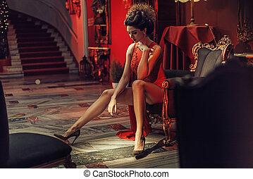 Elegant brunette lady in the stylish interior