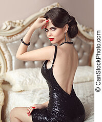 Elegant brunette sexy woman in fashionable black dress....