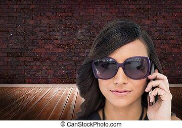 Elegant brunette wearing sunglasses