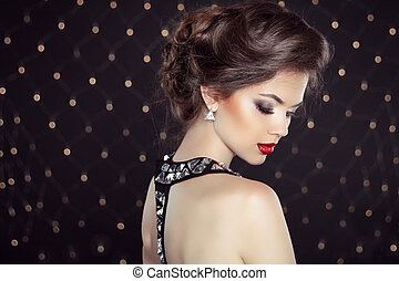 Elegant brunette woman lady with makeup and hairstyle. Fashion g