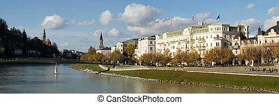 Elegant buildings line the Salzach River, downtown Salzburg, Austria.