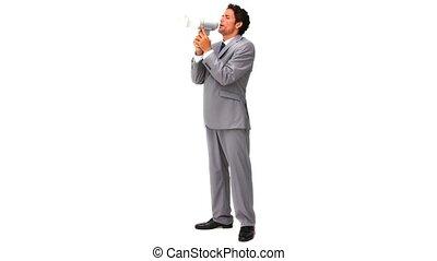 Elegant business man shouting through a loudspeaker against a white background