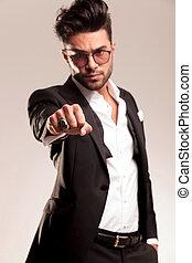 Elegant business man showing his fist