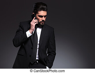Elegant business man talking on the phone