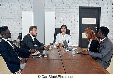 Elegant business partners plan work at meeting in office