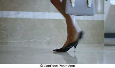 elegant business woman legs entering and passing security ...