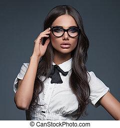 Elegant business woman wearing eyeglasses
