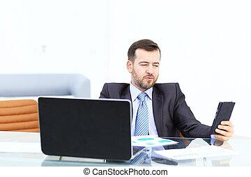 Elegant businessman analyzing data in office