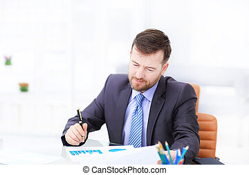Elegant businessman analyzing data in white office