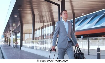Elegant businessman in airport. Young mail entrepreneur in ...