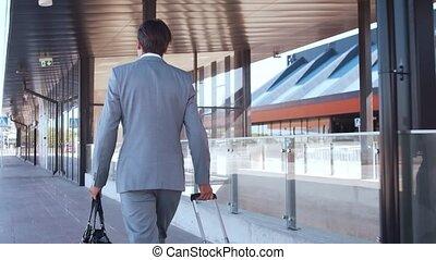 Elegant businessman in airport. Young mail entrepreneur in ...