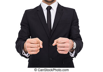Elegant businessman in suit clenching his fists